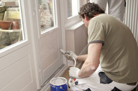 A sydney house painter, painting windows and doors.